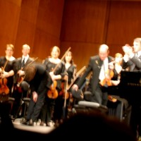 David Kadousch getting applause in front of Orchestre Lamoreux, to the right conductor