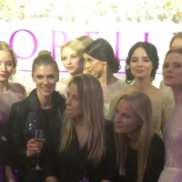 Fashion designer Aurelija Beliakaite, Orelli fashion house, surrounded by her mannequins and her staff. and walls with 10.000 white orkidees. Foto Henning Høholt