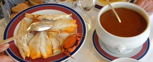 The exquisite bouillabaisse comes in two parts: you add five fishes into the safran red basis.