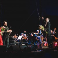 Midsummer Opera concert at The Grand Duke Castle Court Yard in Vilnius, with Lithuanian Chamber Orchestra, conducted by Modestas Pitrenas, (right), Merunas Vitulskis, tenor, (center) and Lilija Gubaidulina , soprano (left).at the encore Libiamo from Verdis La Traviata.